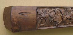 Rustic Fireplace Mantel With Carved Grape Vine. Features Curved Front And Sides With A Flat Top, Back, And Bottom. This Style Mantel Can Also Be