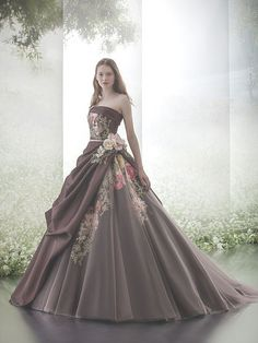 This dress is really unique. I like the merging of the colors. They reflect nature.  And the the style of the dress is really pretty.