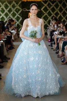 The color of rhapsody and romantic moons, the blue wedding dress is one of our favorite new trends for Spring 2013.
