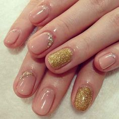The single glitter nail is a popular choice, but it's also a cool idea to trace around portions of your cuticle with that shiny fairy dust.