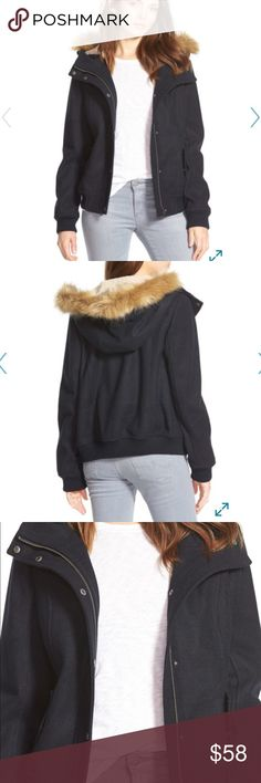 Levi's Faux Fur & Shearling Trim Hooded Bomber. Color is Navy Classic bomber styling defines a warm wool-infused jacket made extra-cozy with an oversized hood lined with plush faux shearling and trimmed with faux coyote fur. Removable trim. - Attached hood with removable faux fur trim - Long sleeves - Front zip and snap closure - Front zip pockets Shell: 71% polyester, 10% acrylic, 9% wool, 6% rayon, 4 other fibers  Fill/Lining/Faux shearling hood lining: 100% polyester Faux fur hood trim…