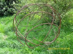 Steel reinforcing bar Circular, Round, Globe like, Disk or Dish shaped #sculpture by #sculptor Orhan Rashtana titled: 'Twisted Ball (Metal Bar Yard/Garden Abstract statues)' £1417 #art