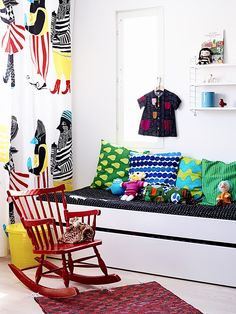 string shelf above a toddler bed + rocking chair in front
