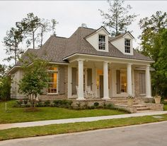 painted brick shutters column | LOVE the Exterior Paint Colors: Columns and stucco are painted in ...