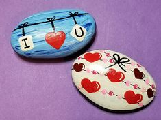 For Valentines Day or any time, choose one of two rocks. First, on a blue streaked sky, a line with the statement I <heart> U strung on it. Second, lines wrap around the rock with hearts and dots strung on them in shades of pink and red.