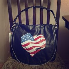 "BLACK TOTE AMERICAN FLAG HANDBAG W SHOULDER STRAP Designer inspired soft leather tote bag. Single carry handle with elegant hardware attachment with heart shape flag. Top zipper closures, fully lined interior with multiple inner pockets. Back pocket with zipper closure. Detachable shoulder strap included. Dimension: 13""W x 12""H x 6""D David Jones Bags Totes"