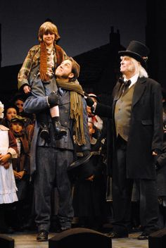 Sam Cooper, Christopher Michael Vecchia and Eric Hill as Tiny Tim, Bob Cratchit and Scrooge in A Christmas Carol. Photo by Abby LePage. www.berkshiretheatregroup.org
