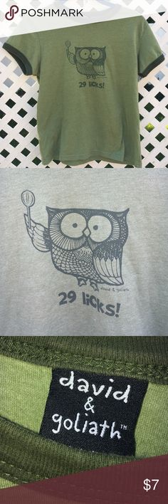 """David & Goliath vintage t shirt medium EUC green This vintage looking David & Goliath green t shirt says size medium but it fits more like a small. It has the Tootsie Roll Pops' owl on it, saying """"29 licks!"""" Excellent used condition (EUC). David & Goliath Tops Tees - Short Sleeve"""