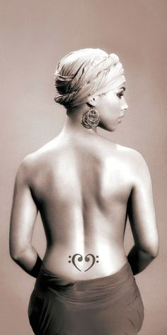 Alicia Keys. Beautiful photo, love the tattoo