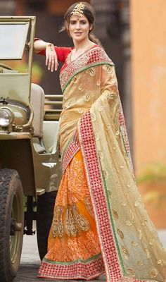 Don this orange and beige color raw silk half n half sari. Beautified with lace and resham work. Upon request we can make round front/back neck and short 6 inches sleeves regular saree blouse also. #AmazingColorsOfPartyWearSaree