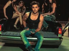 Step into the back of this pickup truck with Zac Efron in the new John John Denim ad campaign.