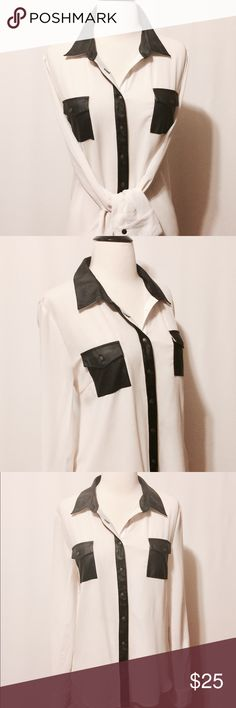 """✨Cream Chiffon Blouse with Black Leather' Trim Cream chiffon with black vegan leather trim. Featuring patch pockets with flaps, placket collar and stand in leather accents. Cuffed sleeves and back yolk. Slight hi-low hemline. 100% Polyester Machine Washable 40"""" Chest 25"""" Sleeve length 25""""Overall length Tops Blouses"""