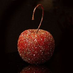 These German glass glitter Christmas ornaments only look high end and expensive! Learn how to turn dollar store finds into amazingly elegant fruit!