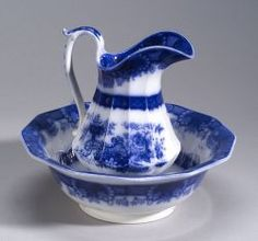 "Flow Blue ""Indian Jar"" Pattern Pitcher and Basin by Jacob & Thomas Furnival, Hanley, Staffordshire, England, c.1843-80. Pitcher (10 3/4"" tall) & bowl (13 5/8"" wide) with twelve sides. Sold at auction for $588 in 2004."