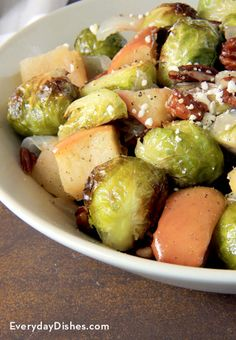 We'd hungrily dig into a serving of roasted Brussels sprouts served up any which way, but mixed with sweet apples, crunchy pecans and feta…that's hard to beat!   - Everyday Dishes & DIY