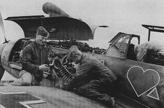 Gunsmiths for recharging guns fighter Bf.109F-4 from Group 3 of the 54th Fighter Squadron of the Luftwaffe