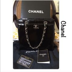"""💯% Authentic Chanel patent leather tote Authentic small/med Black patent Chanel classy handbag with silver hardware. Pristine like new condition barely take her out . Front and back pockets. Zipper pocket inside heigh approx 9"""", dept approx 4"""", length 10.5. Shoulder drop approx 17"""". With box/dust bag/authenticity card matches with hologram sticker/care booklet and box. 🚫NO TRADE 🚫 . Slight water spot like at bottom but no one can see it at the base . See pic #4.  """"Price to sell"""" CHANEL…"""