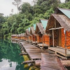 Stamp #536 - Float on  These bungalows are located at Cheow Lan lake in Khao Sok National Park Thailand. A two day trip is highly recommended because of the jungle treks to waterfalls and caves kayaking on the lake and boat rides through the morning mists. Thank you @pinkflightlessbirds for sharing your #stamp! For more adventures and travel tips download the Stamp Travel App today. The link is in our bio!