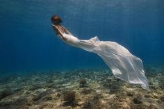 Floaty white underwater scene - mermaid