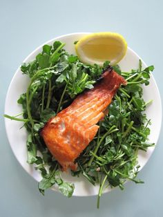 Pan Fried Salmon Fillet over Watercress with Balsamic and Honey Vinaigrette.