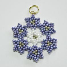 beaduing patterns | Peanut Bead Flower Pendant Pattern | Bead Flowers