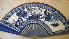 HAND PAINTED BLUE & WHITE FAN WITH AN ORIENTAL SCENE