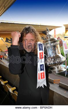 Robert Plant former led zeppelin singer with the FA Cup at Molineux Stadium the home of his team Wolverhampton Wanderers. - Stock Image