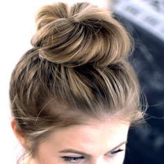 This video shows how to do a mess y top knot style that's great to take from day to night. Create this hair by getting the products listed.