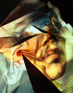 Really cool photography project using crumpled magazine pages. By Ofer Wolberger