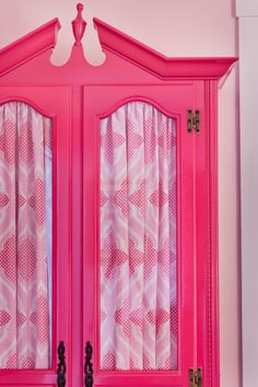 Hot pink armoire with fabric lined doors