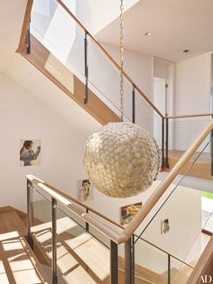 A vintage Murano-glass pendant light illuminates the central staircase of this Hamptons home, designed by architect Annabelle Selldorf and designer Joe Nahem.   archdigest.com