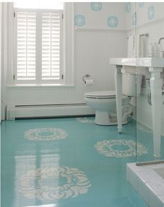 Subfloor painted blue with white stenciled design on top.