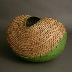 'Green boat' (basket) by LA-based Costa Rican ceramic artist Hannie Goldgewicht. Pine needles, clay. via the artist's site