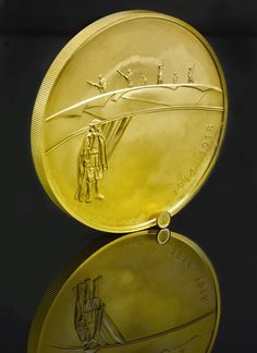 The First World War gold kilo coin and the 40th oz gold Britannia coin  http://www.royalmint.com/