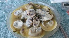 Portabella mushroom ravioli with white mushrooms in a wine, butter and ...