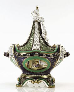 A Pot-pourri Vase and Cover in the shape of a ship (vase 'pot pourri à vaisseau') c. 1761.    Sèvres soft-paste porcelain, decorated with an underglaze blue and an overglaze green ground, painted with birds and gilded.