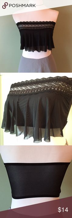 Black ruffle crop top NEW small-medium Brand new, black ruffle crop top. Stretchy sheer back. So pretty and unique. Stretchy lace around the top. Has small inside loops to attach straps (not included) but not necessary to keep it up. Fits small- medium. I'd say up to a small D cup but doesn't give support. I also have this in white. Amoralia Tops Crop Tops