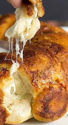 Chicken Ranch Monkey Bread Recipe ~ Ranch flavored chicken is stuffed inside biscuit dough, then dipped in more ranch flavored butter and then tossed with cheese and bacon before being baked to a golden brown.