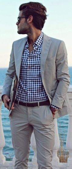 Blue/White Plaid Dress Shirt • (not necessary) Neutral Coat Jacket • Khakis • Black Belt