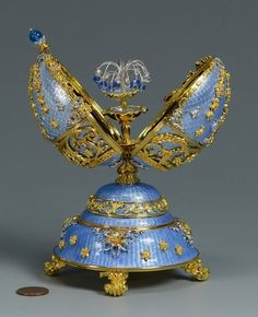 """Franklin Mint House of Faberge egg music box, """"The Peter Carl Faberge 150 Anniversary Imperial Egg Fountain of Jewels"""". Crafted of sterling silver with gold accents, white sapphires … Objets Antiques, Fabrege Eggs, Franklin Mint, Egg Art, Russian Art, Blue Crystals, Oeuvre D'art, Jewelry Box, Perfume Bottles"""