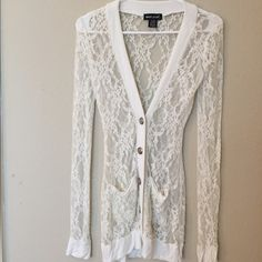 White Lace cover up So cute and flirty. White lace button up. Perfect over a black camisole! Wet Seal Tops