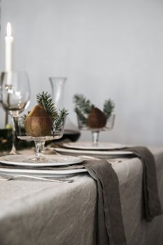 Dishing It Out - Such a sweet table setting — a pear, plus a few tiny tree clippings, all nestled into a dish. Natural Christmas, Noel Christmas, Rustic Christmas, Simple Christmas, Beautiful Christmas, Christmas Table Linen, Xmas, Nordic Christmas, Christmas Table Settings
