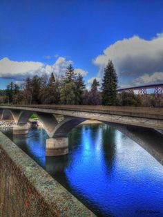 I love how structure bends the light. Dieselhorst Bridge in Redding CA by Jeanean Gendron