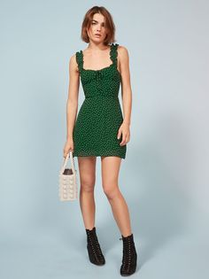 Ruffles, not like chips. This is a mini length dress with ruffled straps and a sweetheart neckline.
