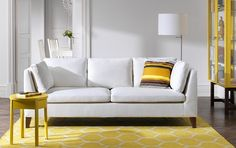 STOCKHOLM three-seat sofa with Röstånga white cover and STOCKHOLM yellow bedside table and glass-door cabinet