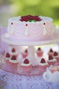 The Frosted Petticoat: Dream Tea. I like the arrangement, with the cupcakes under the cake pedestal.