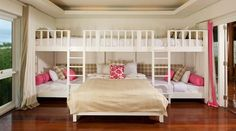 A queen bed, two loft beds and cozy seats in one room.--- seriously best sleepover ever