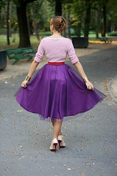 so i was thinking to make a repunzel costume. to use a tulle skirt like this. with a pink/purple top with a makeshift ribbon corset from. :)