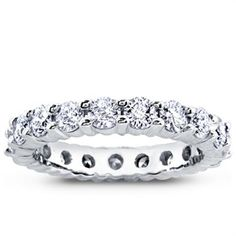 This diamond eternity band is set with nineteen round diamonds totaling 2.14ct. This setting is available white or yellow gold and platinum.
