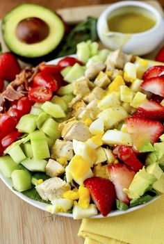 California Cobb Salad with Tarragon Vinaigrette gives the Cobb Salad a west coast spin with the addition of crisp cucumber, sweet strawberries, and creamy avocado. | iowagirleats.com